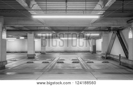 Empty space car park interior at night
