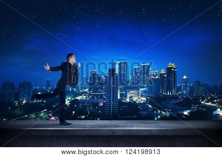 Successful Business Man On The Rooftop At Night Time