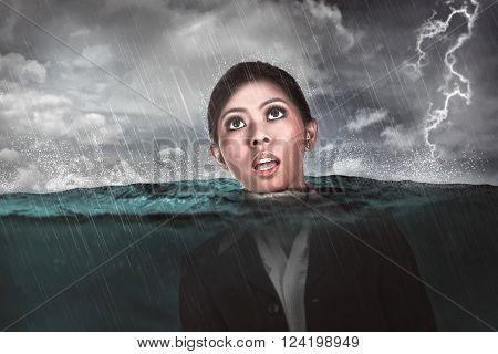 Asian Business Woman Drown In The Middle Of The Sea