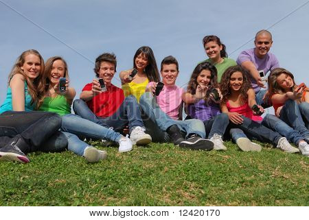 group diverse teens with cell or mobile phones