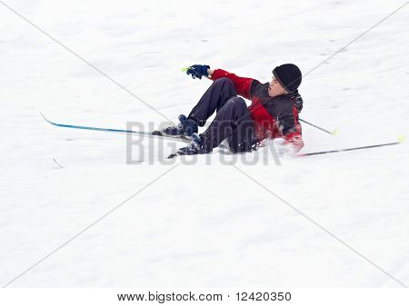 Boy Skier fell on snow