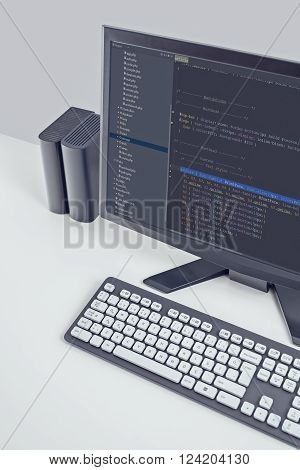 web site codes on computer monitor on office desktop