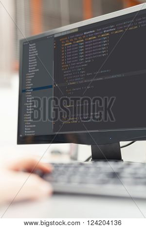 developer working on source codes on computer at office