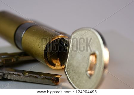 Close up keys and lock Cylinder on white background ** Note: Shallow depth of field