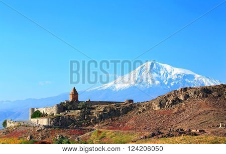 Ancient monastery on background of mountains in the morning time
