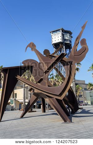 SPAIN, BARCELONA, JUNE, 27, 2015 - Sculpture Homenaje a la natación (Tribute to the swimming - 2004) by Alfredo Lenz on Placa del Mar in Barcelona, Catalonia, Spain.