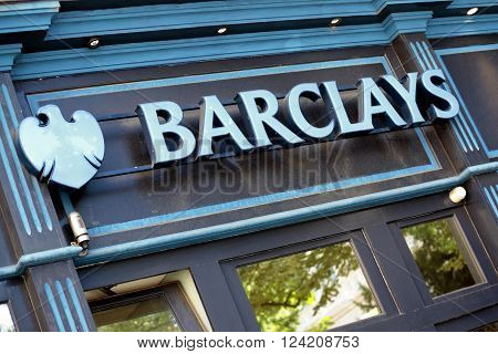 DIJON, FRANCE : SEPTEMBER 9, 2013 - Sign and logo above the entrance to an overseas French branch of Barclays Bank in Dijon France