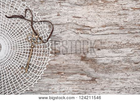 Vintage Background With Old Key And Lace On Rude Wood