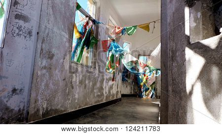 It is taken on the hill next to Nam Co, means heavenly lake. The abandoned houses is covered by colorful prayer flags. poster