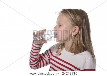 cute sweet little girl with blue eyes and blond hair 6 or 7 years old holding bottle of water drinking isolated on white background
