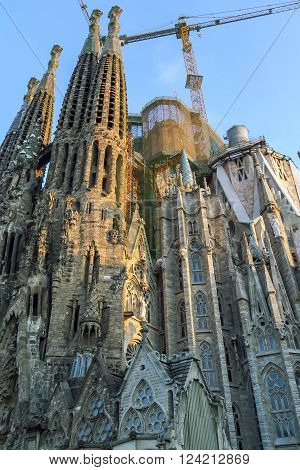 The Basilica and Expiatory Church of the Holy Family (Sagrada Familia) is large Roman Catholic Church by Catalan architect Antoni Gaudi, building is begun in 1882 and completion is planned in 2030 in Barcelona, Catalonia, Spain. poster