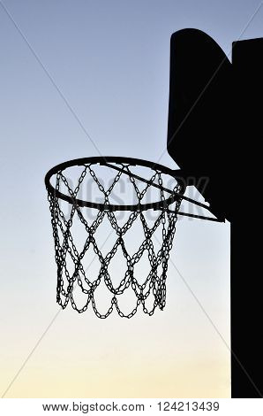 isolated basketball hoop at sunset inb summer