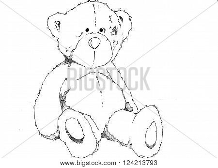 Black and white teddy bear sitting down