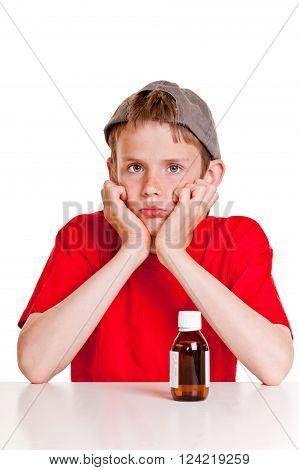 Sulking Teenager With Medicine Bottle