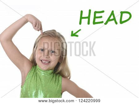 6 or 7 years old little girl with blond hair and blue eyes smiling happy posing isolated on white background pointing head in learning English language school education body parts card set ** Note: Soft Focus at 100%, best at smaller sizes