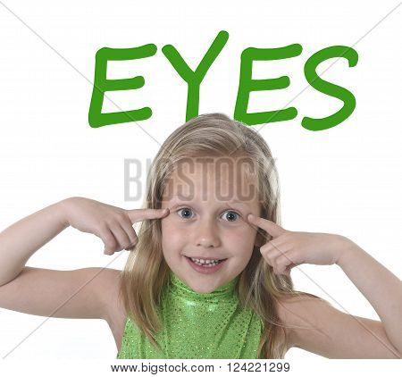 6 or 7 years old little girl with blond hair and blue eyes smiling happy posing isolated on white background pointing eyes in learning English language school education body parts card set