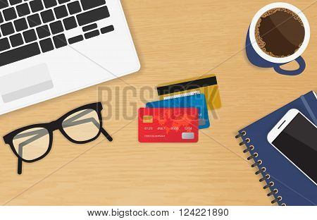 Realistic workplace with three credit cards concept of online payment and shopping. Top view with textured table, laptop, smartphone, diary, glasses, and coffee mug