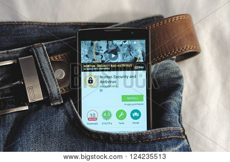 SARANSK, RUSSIA - April 3, 2016: Photo of Smartphone in a jeans pocket with Norton Security and Antivirus application in a Google Play Store on the screen.