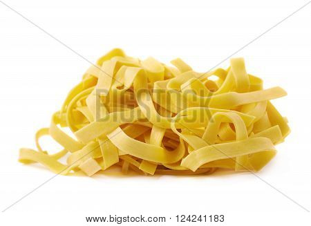 Pile of fresh raw fettuccine ribbon pasta isolated over the white background