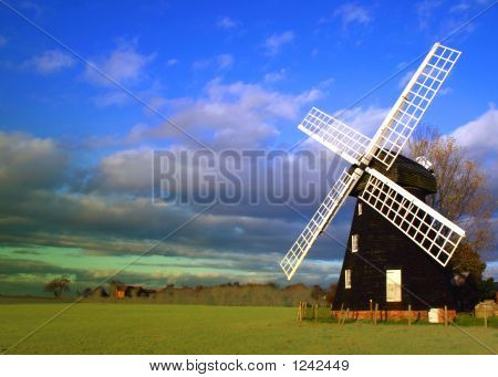 lacey green windmill in the buckinghamshire chilterns dates from 1650 and is the oldest smock design windmill in england. photographed early evening poster