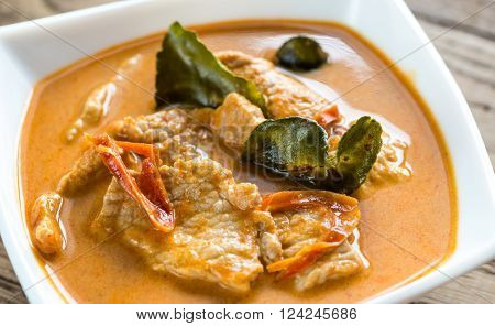 Bowl of thai panang curry on the wooden table ** Note: Shallow depth of field