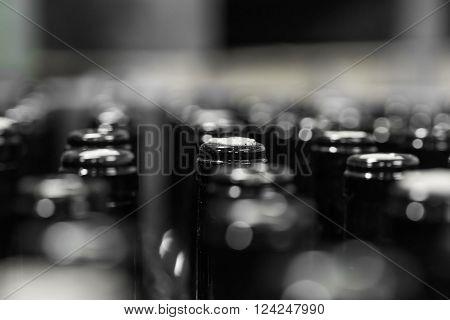 wine bottles on the conveyor production of wine