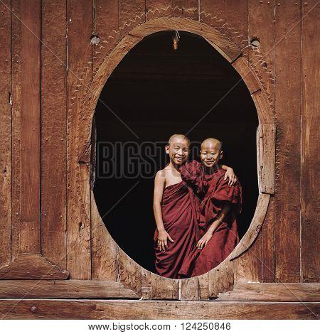 Nyaung Shwe, Myanmar - March 24, 2014: Novice Buddhist monks smiling at Shwe Yan Pyay Monastery in Nyaung Shwe village near Inle Lake, Shan State, Myanmar (Burma).