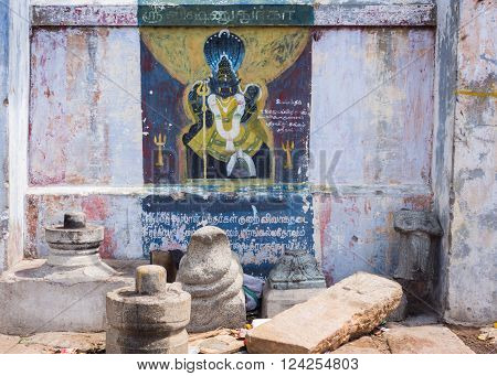 Trichy, India - October 15, 2013: Painting on shrine wall at Amma Mandapam of Lord Vishnu in royal lion avatar, called Narasimha. Seven headed cobra as background.