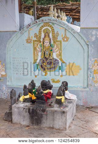 Trichy, India - October 15, 2013: Painting on shrine wall at Amma Mandapam of Vishnu-Durga goddess. Powerful image of Vaishnavism. Navragrahas worn nine statues front.