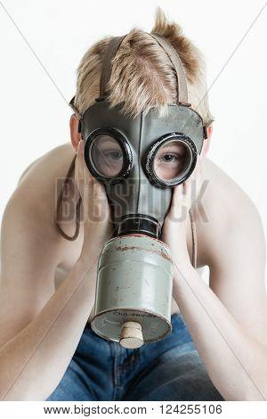 Shirtless Child Wearing Gas Mask