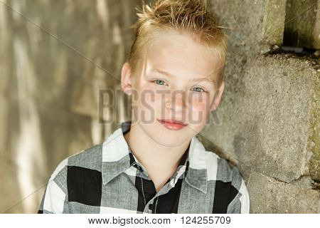 Grinning Handsome Boy Near Stone Wall