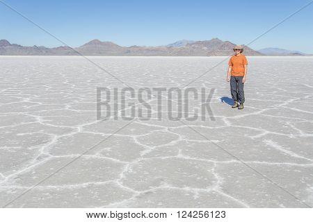 A tourist enjoying the Bonneville Salt Flats in Utah