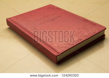 Red rectangular notebook leather bound in oriental style