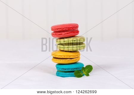 Colorful macarons on white background. Macaron or Macaroon is a French meringue-based confection.