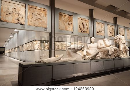 ATHENS GREECE - JANUARY 28 2011: Metopes and pediment on the 3rd level of the New Acropolis Museum at night with no people