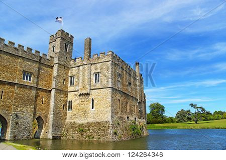 Leeds Castle in the island on the lake in Kent in England. The castle was built in the twelfth century as a king residence. Now it is open to the public.
