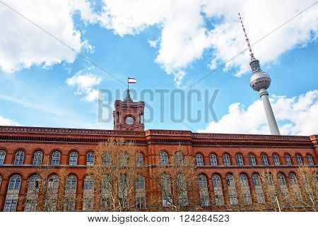 Red City Hall and Berlin TV Tower in Berlin in Germany. This television tower is the tallest tower in Germany. The Rotes Rathaus is the city hall in Berlin.