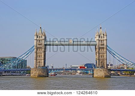 Tower Bridge over River Thames in London UK. Tower Bridge is suspension and bascule bridge in London. It crosses the Thames River and is an iconic symbol for London.