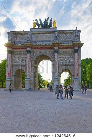 PARIS FRANCE - MAY 3 2012: Triumphal Arch in Paris in France. The Arc de Triomphe du Carrousel is a triumphal arch of Paris and is located in the Place du Carrousel