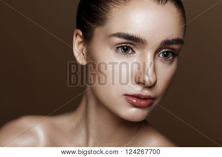 Strobing Or Highlighting Makeup. Closeup Portrait Of Beautiful Girl With Strobing Highlighter Powder