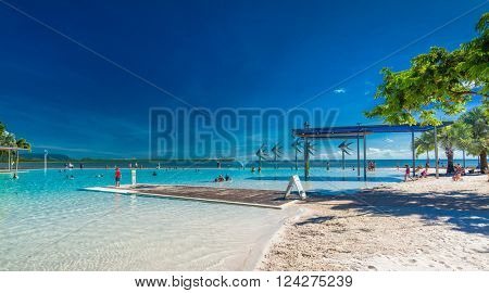 CAIRNS, AUSTRALIA - 27 MARCH 2016. Tropical swimming lagoon on the Esplanade in Cairns with artificial beach, Queensland, Australia.