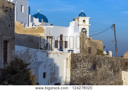 White house and churches in town of Imerovigli, Santorini island, Thira, Cyclades, Greece