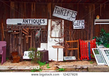 View of antiques thrift store with various items displayed.