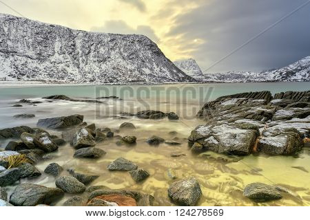 Haukland Beach in the Lofoten Islands Norway in the winter at dusk.