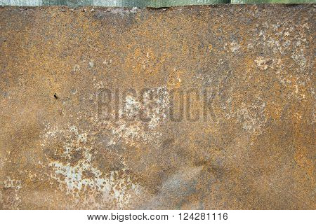 Rusty brown old punched sloppy metal sheet