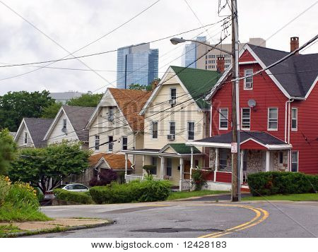 View of row houses with high rise development the background.