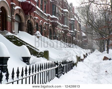 Brownstone apartment buildings after snowstorm in New York City poster