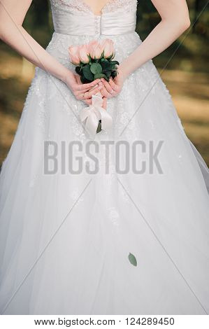 Back Of Beautiful Bride With Bridal Bunch