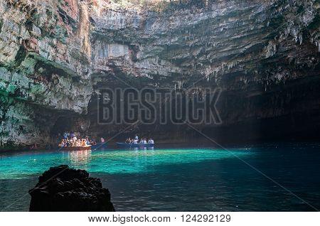 Cephalonia Greece - August 30 2015: Tourists take a boat trip on the beautiful Melissani Lake.