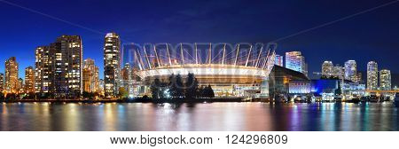 VANCOUVER, BC - AUG 17: BC Place Stadium at night with city buildings on August 17, 2015 in Vancouver, Canada. With 603k population, it is one of the most ethnically diverse cities in Canada.